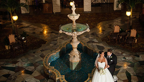 Bride and Groom in Fountain Lobby
