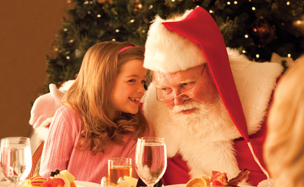 girl and santa eating a mean together sharing secrets