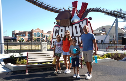 Family in front of candymonium sign