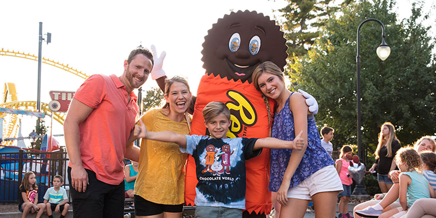 family posing with Reese Character